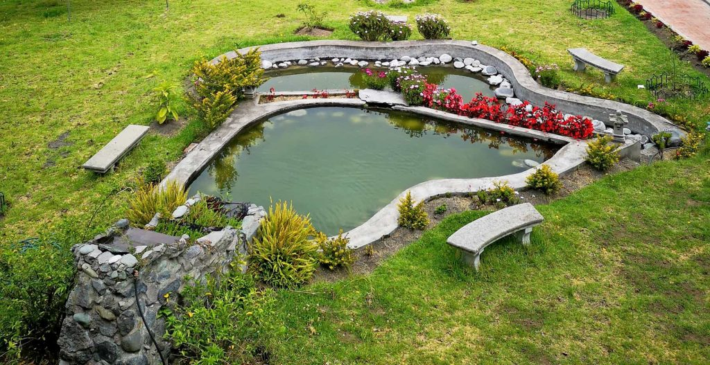 A three tier water feature on a slope