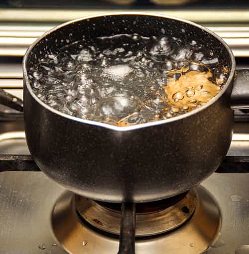Boiling water for ice